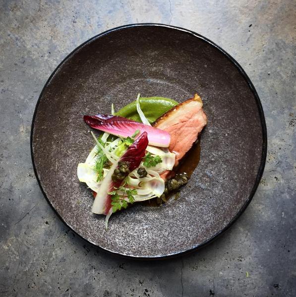 modern australian dish of roasted lettuce, duck hearts and z'ataar