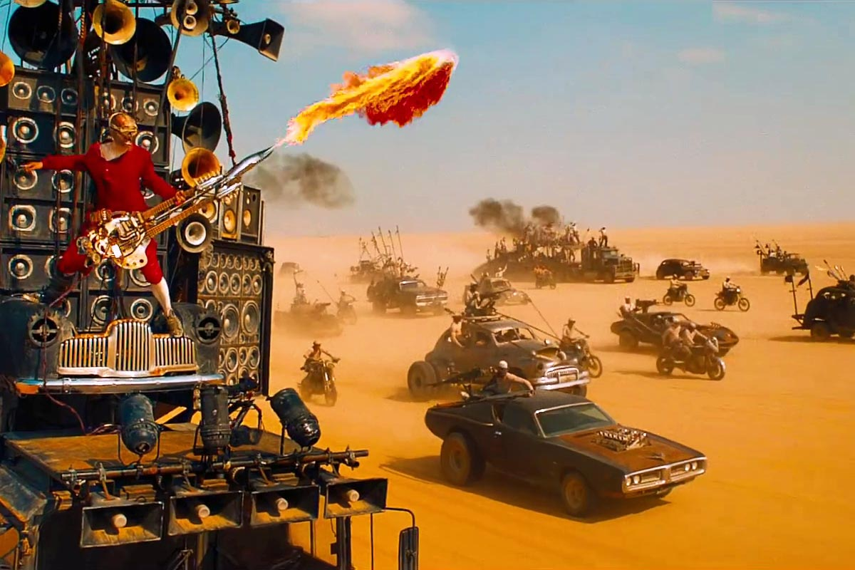 iOTA plays The Doof Warrior,the most   \m/ METAL \m/   character in the year's most   \m/ METAL \m/   film,  Mad Max: Fury Road.