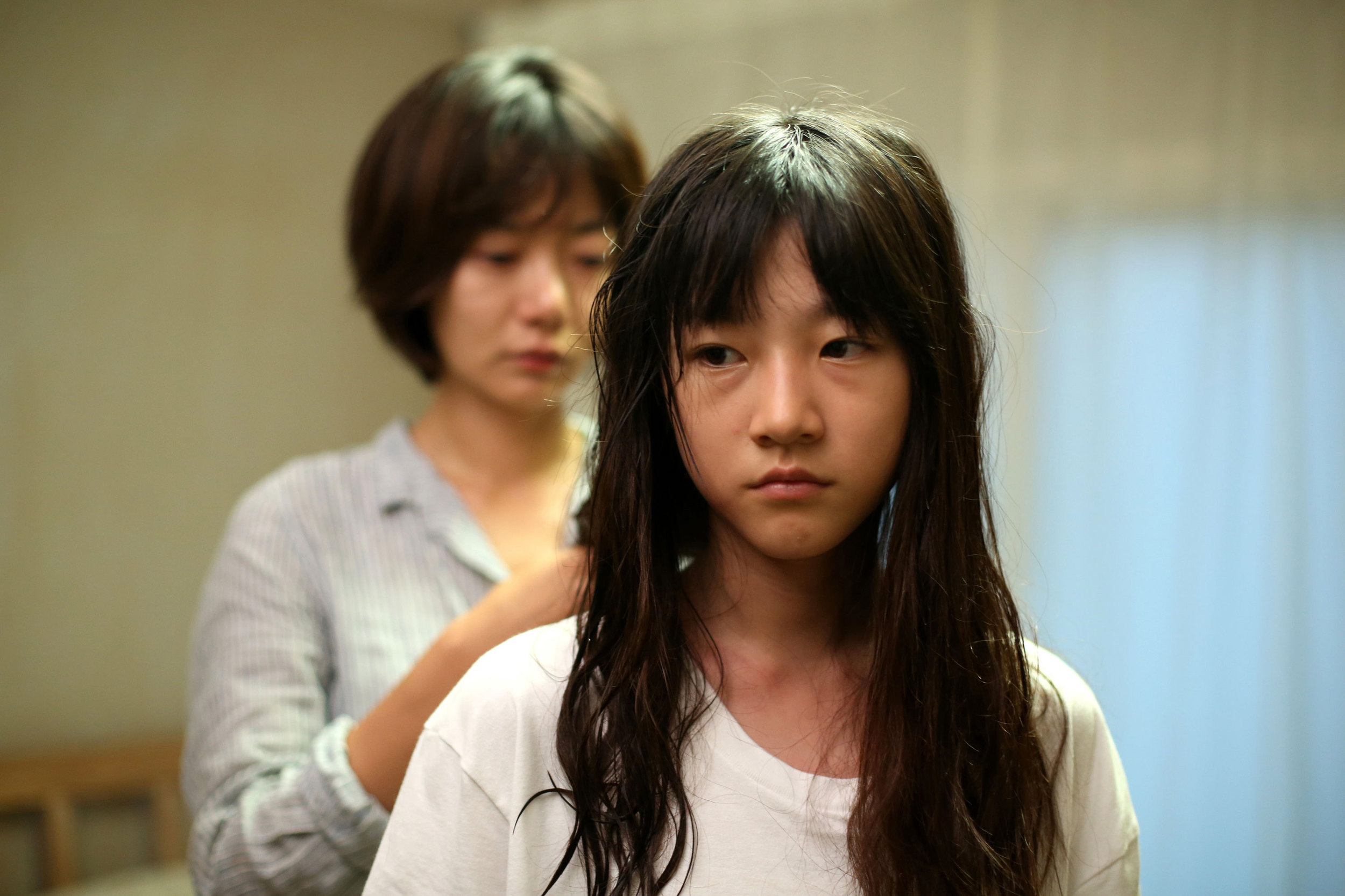 Bae Doona takes Kim Sae-ron under her wing in  A Girl At My Door ( 도희야  –    Dohui-ya).