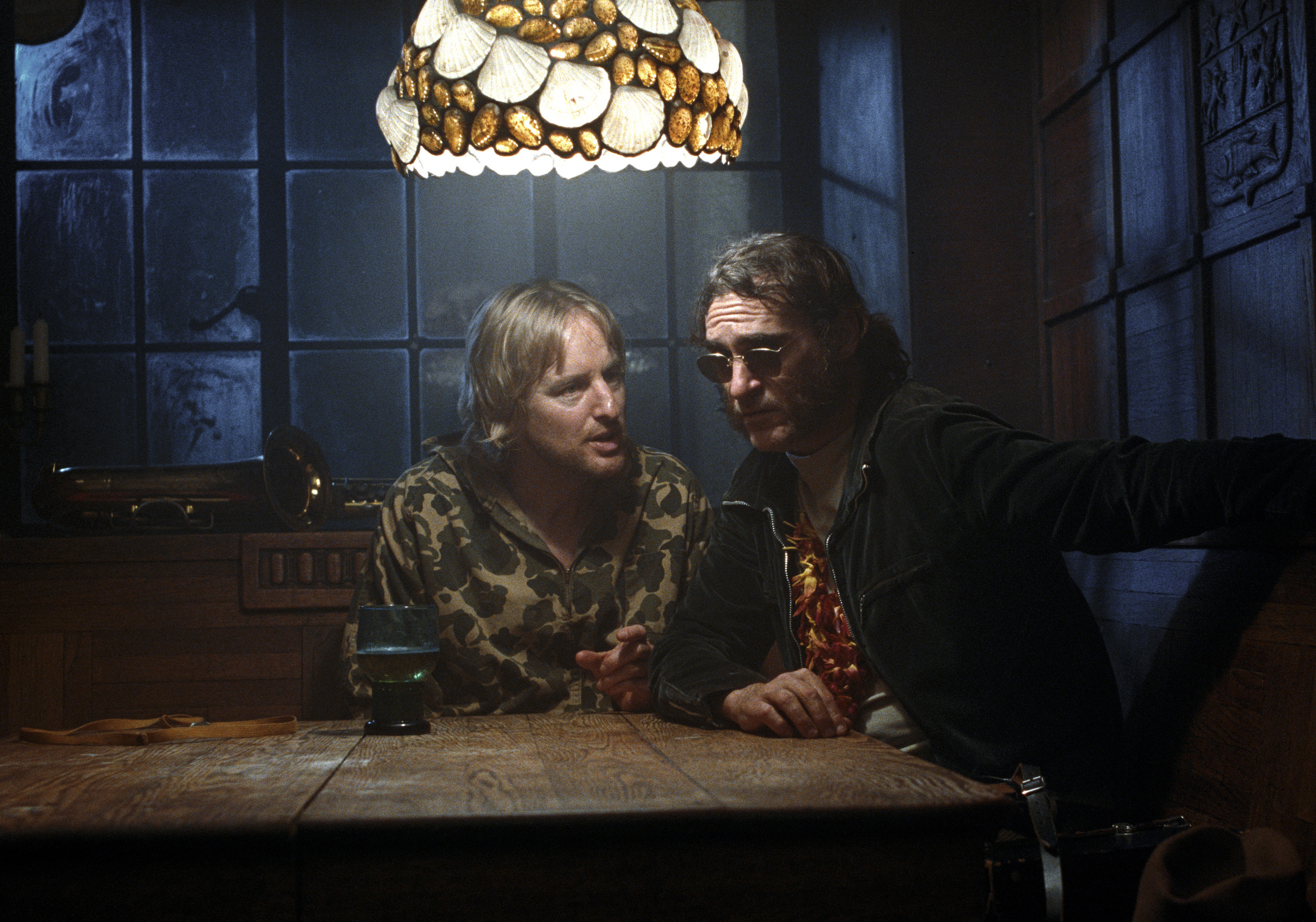 Owen Wilson and Joaquin Phoenix shamble through the dense web of intrigue in  Inherent Vice.