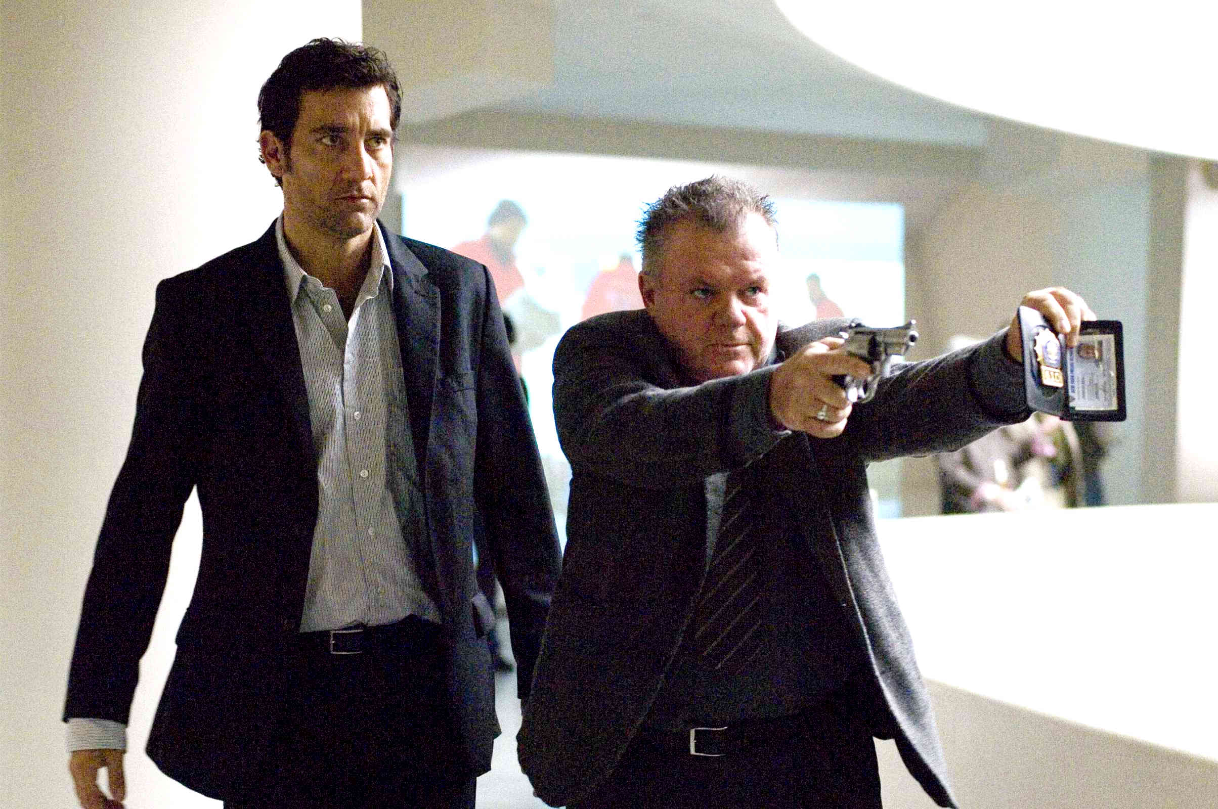 Clive Owen gets ready to shoot up the Guggenheim museum in the show-stopping central set piece of  The International  (2009).