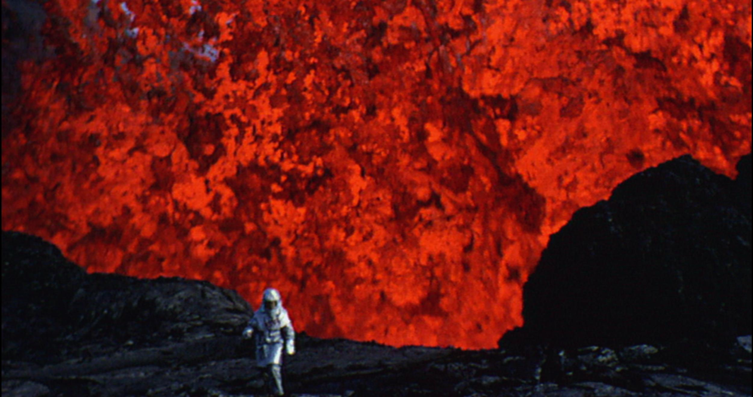 Archival footage of scientist Maurice Krafft being drawn, like a moth to a flame, perilously close to titanic lava flows in  Into the Inferno  (2016).