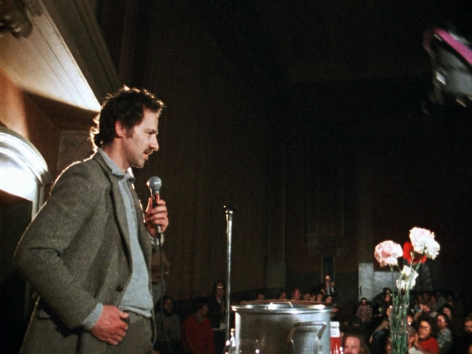 Werner Herzog addresses an audience of film fans and rubberneckers in Les Blank's superb short documentary, Werner Herzog Eats His Shoe  (1980).