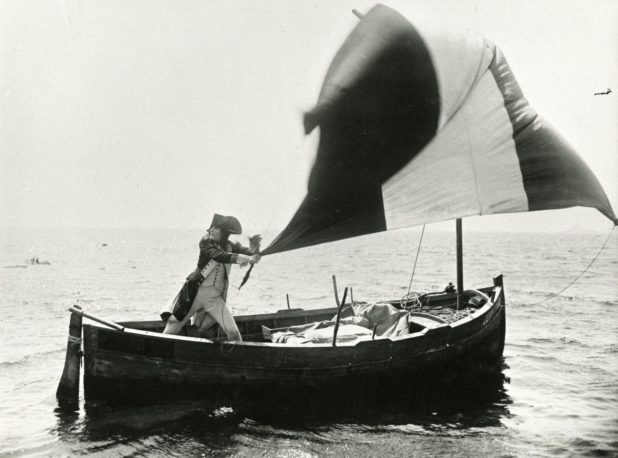 Napoléon Bonaparte makes a heroic escape with the tricolour as his sail.