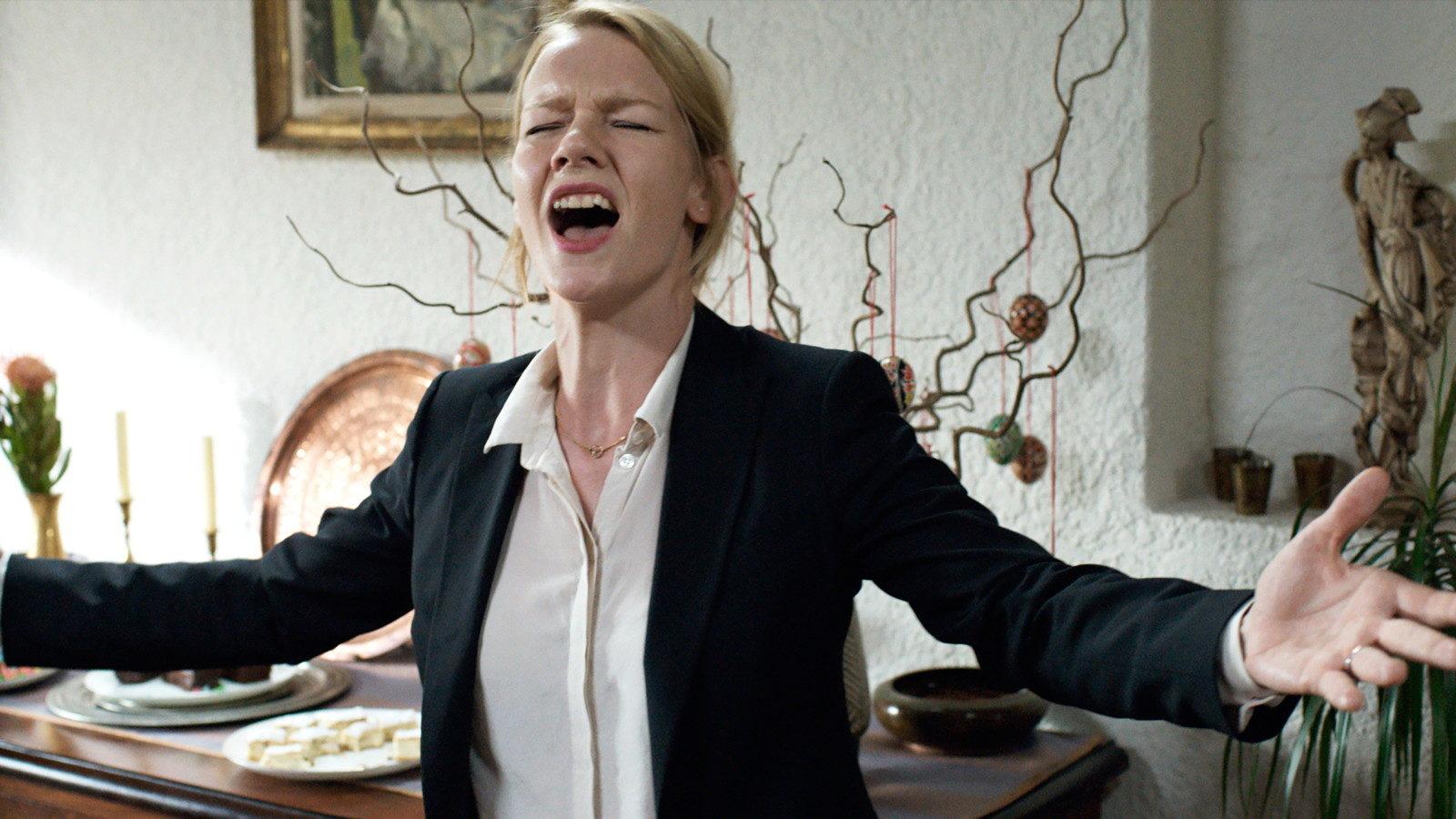 Sandra Hüller as Ines in full flow, singing 'The Greatest Love of All', in  Toni Erdmann .