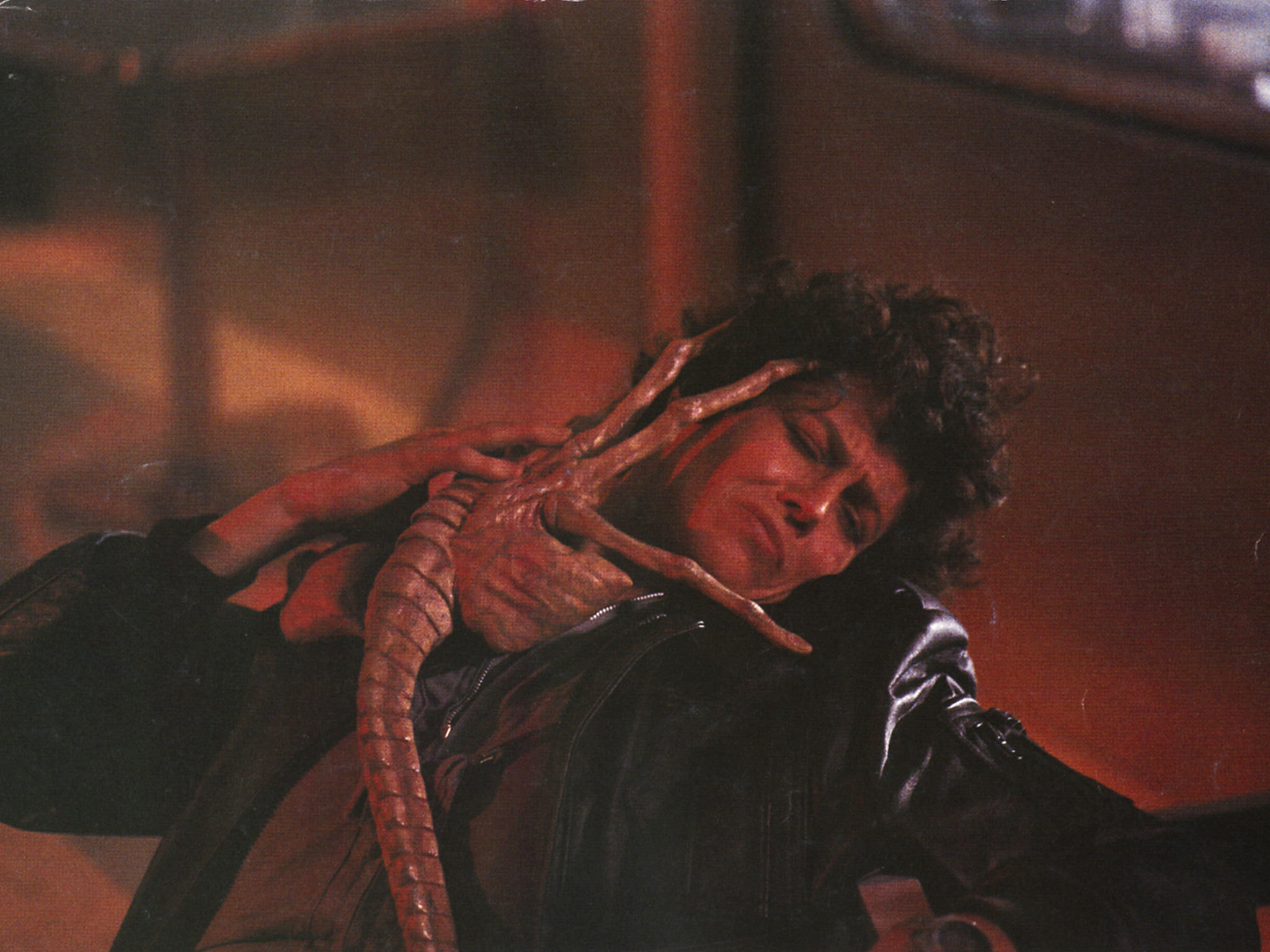 Sigourney Weaver and a facehugger in Aliens 1986