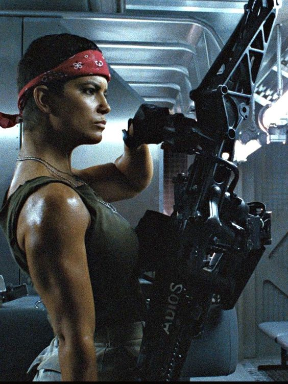 Jeanette Goldstein as Vasquez models one of the servo-arm-mounted rifles in the marines' considerable arsenal. Weaponry was a key factor in the design aesthetic of Cameron's film, and reflected the beauty (and fetishism) of the aliens as perfect living weapons.