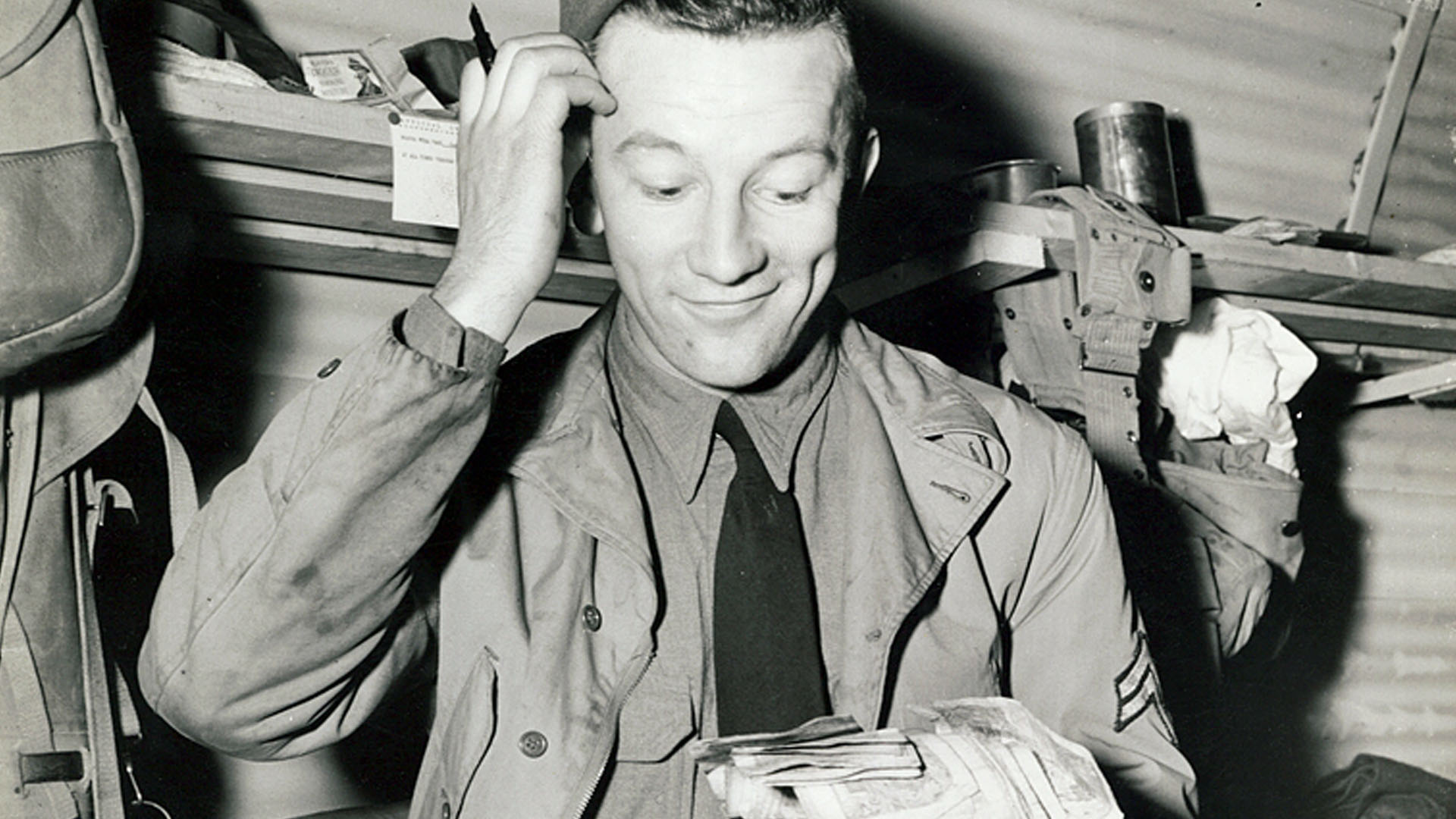 Washington County Free Library Photo WCRH019. Part of the General Russell P Hartle Collection. An American GI struggles to make head nor tail of British currency after the US Army's first payday in Northern Ireland. Photo taken on 16th March 1942. Copyright United States Signal Corps.