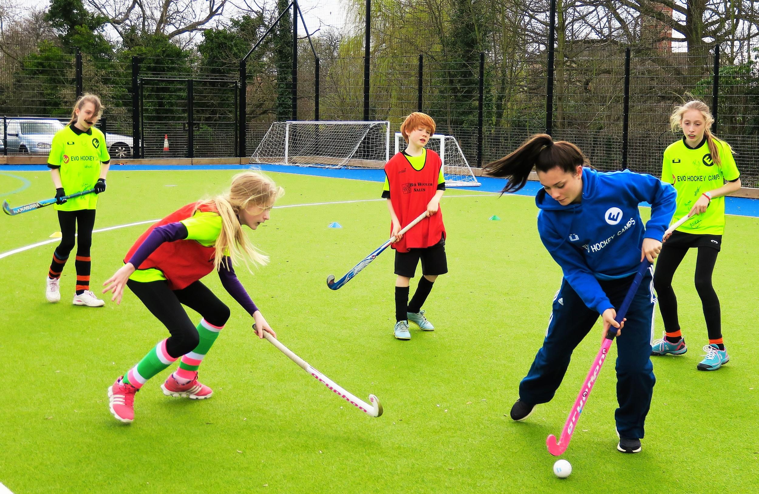 Harriet coaching with EVO Hockey