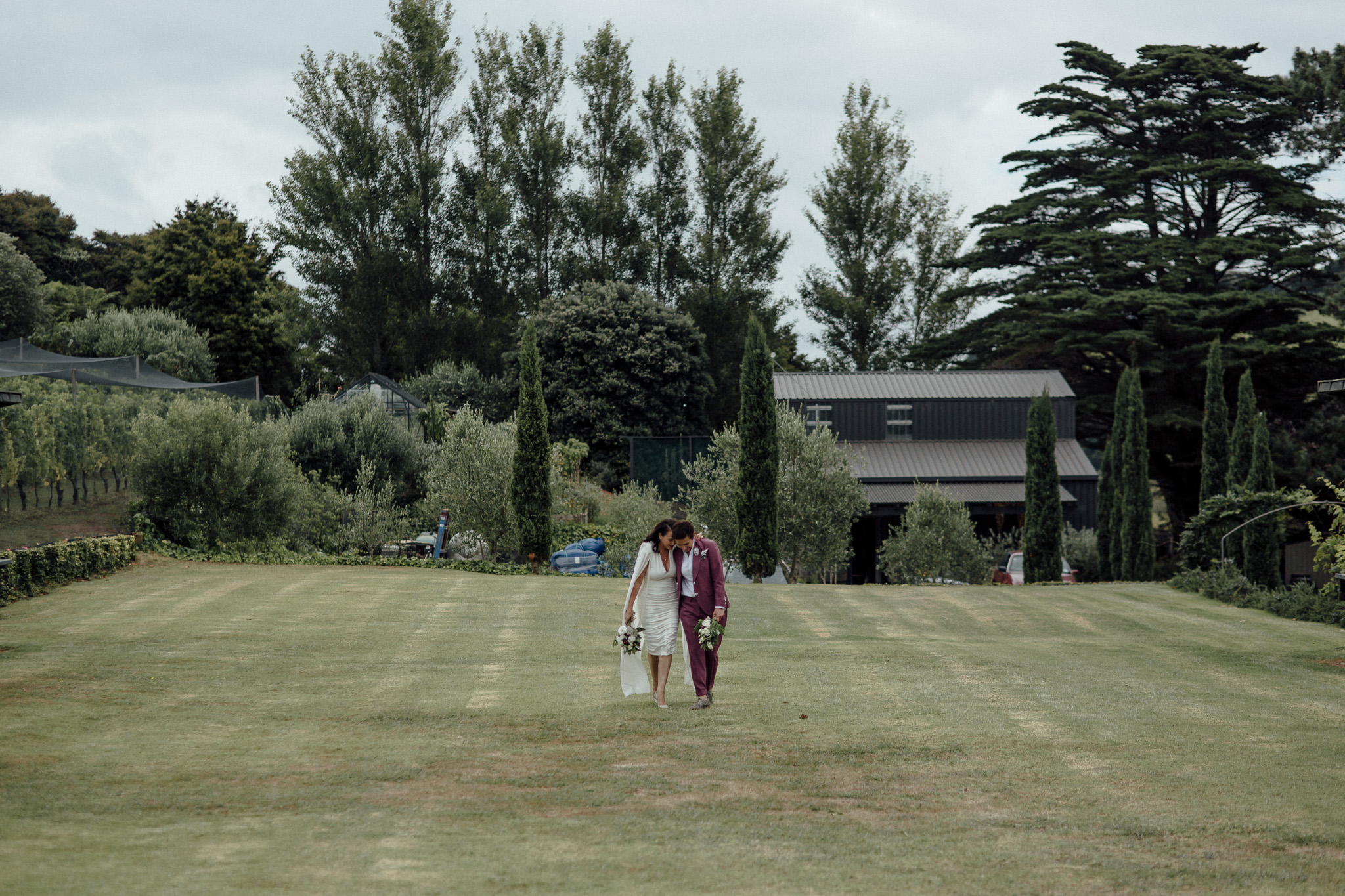 Walking up our very long grassy aisle about to be married, too excited to feel tired  Image by  Free the Bird