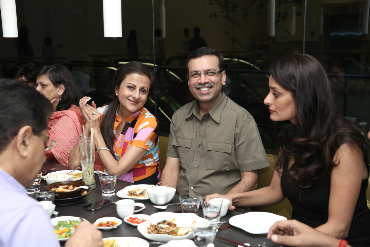 Mr Goenka- with guests at table.jpg
