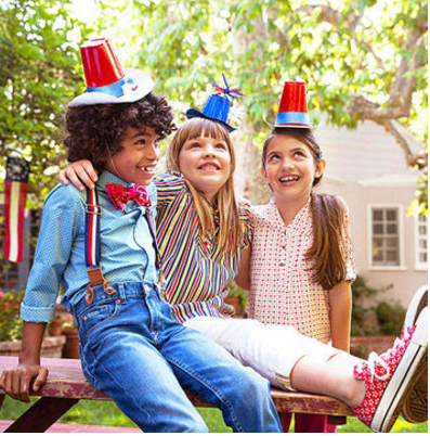 (Image Credit: Laura Doss)      Take out your craft supplies and let you kids make their very own 4th of July customised hats.  You'll need:disposable plastic cups (preferably red) and a variety of crafts the kids can use to decorate their hats - plus some glue, tape, pipe cleaners and paper card (blue or white).  To make sure hats stay on, use an elastic beading cord with knots at the end. Secure the ends by using tape and attaching the cord inside the plastic cups.  Original Idea Here: http://www.parents.com/holiday/july-4th/fourth-of-july-party-ideas/