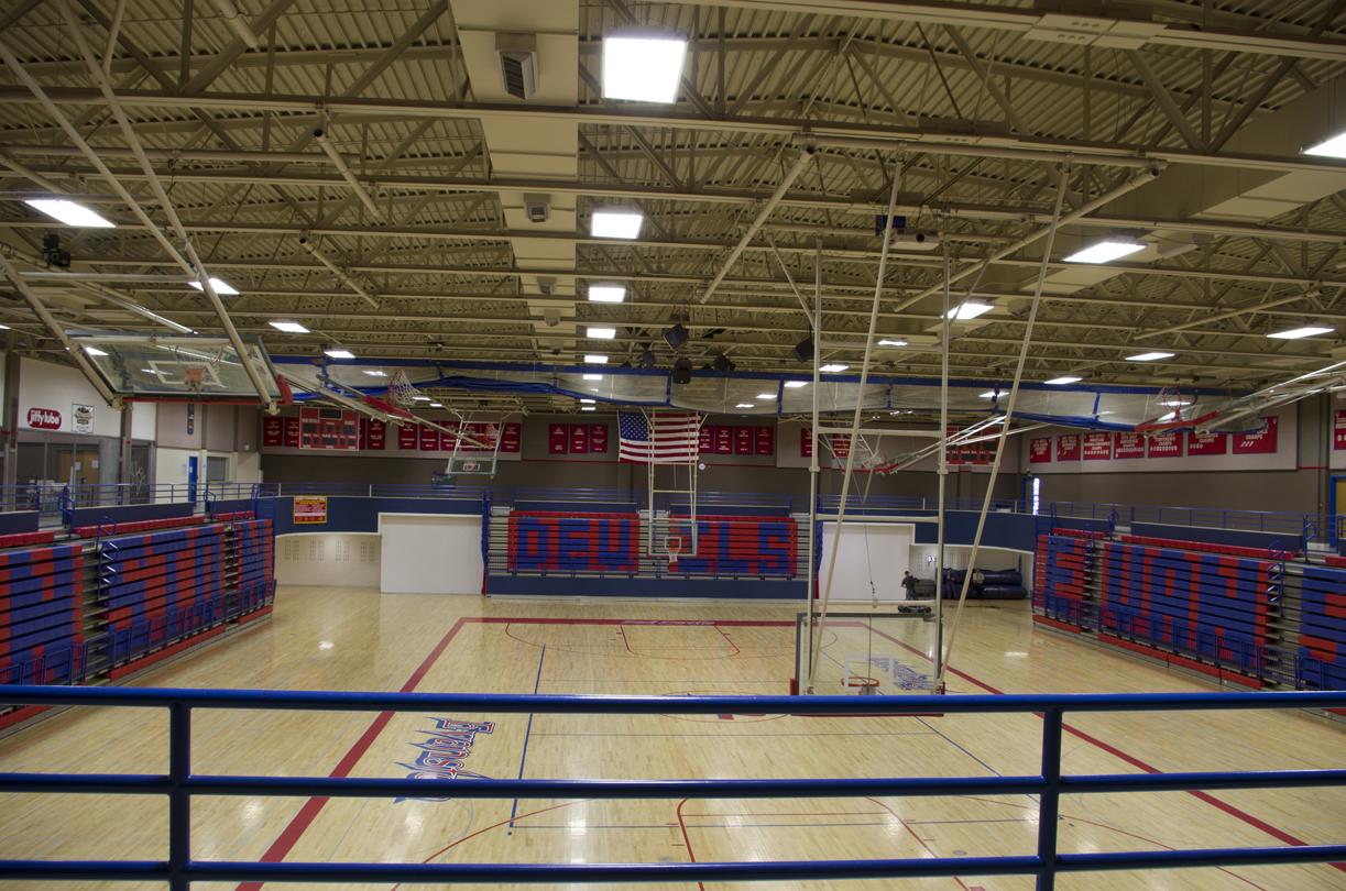 Multiple highschool gymnasium bleacher banks