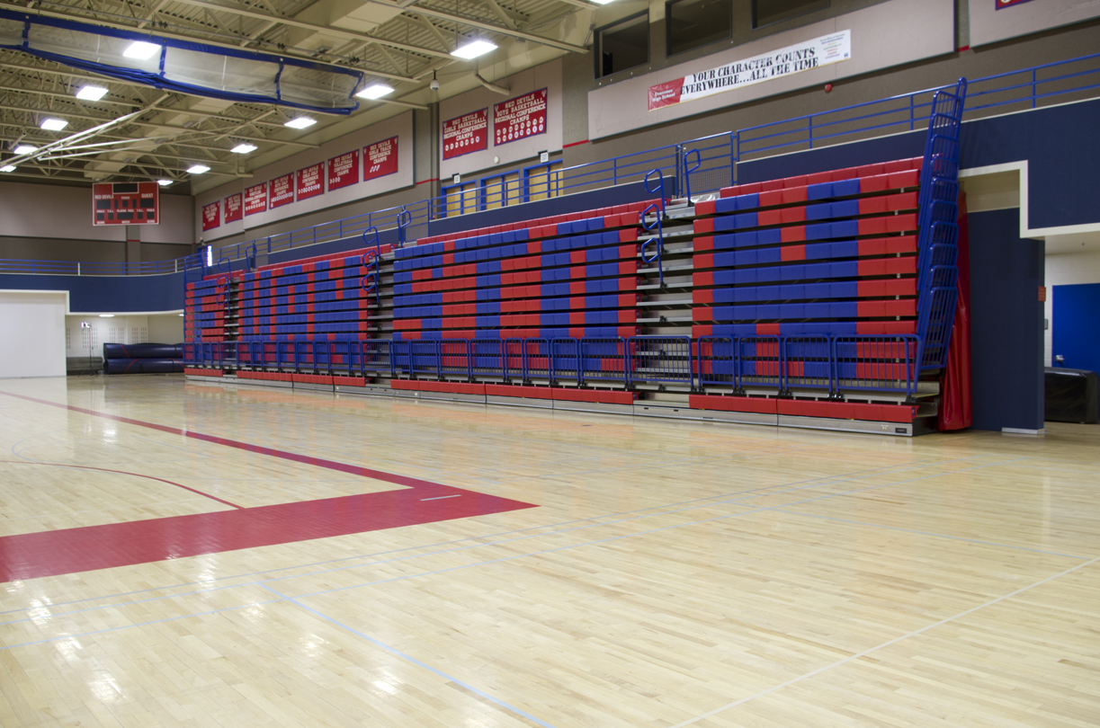 Wall attached bleacher banks in high school gym in Wyoming