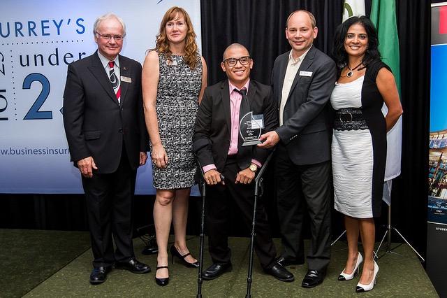 Calvin Tiu receiving his award