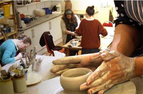 people making pots.JPG