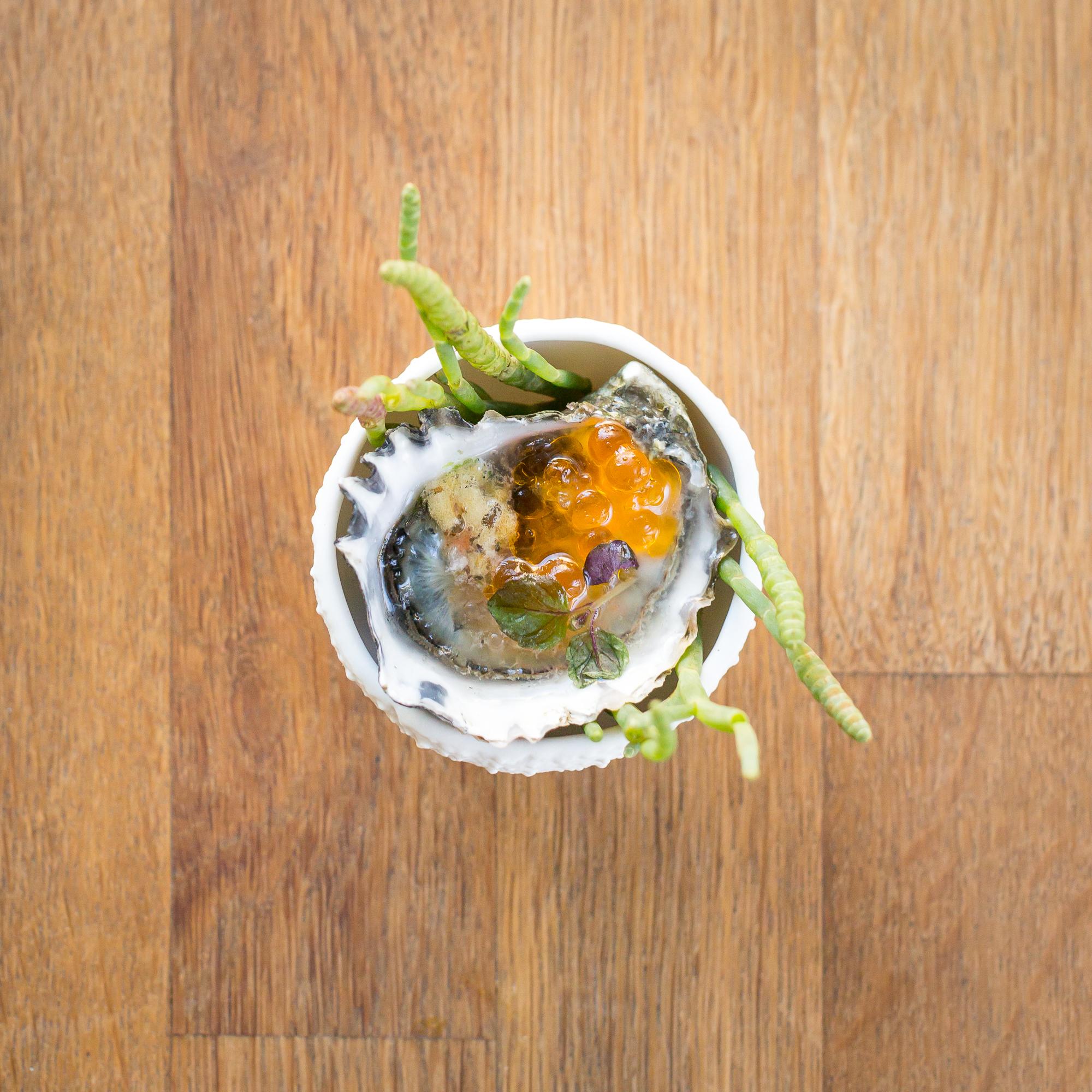 kumamoto oyster with chili caviar/finger lime/furikake poprocks