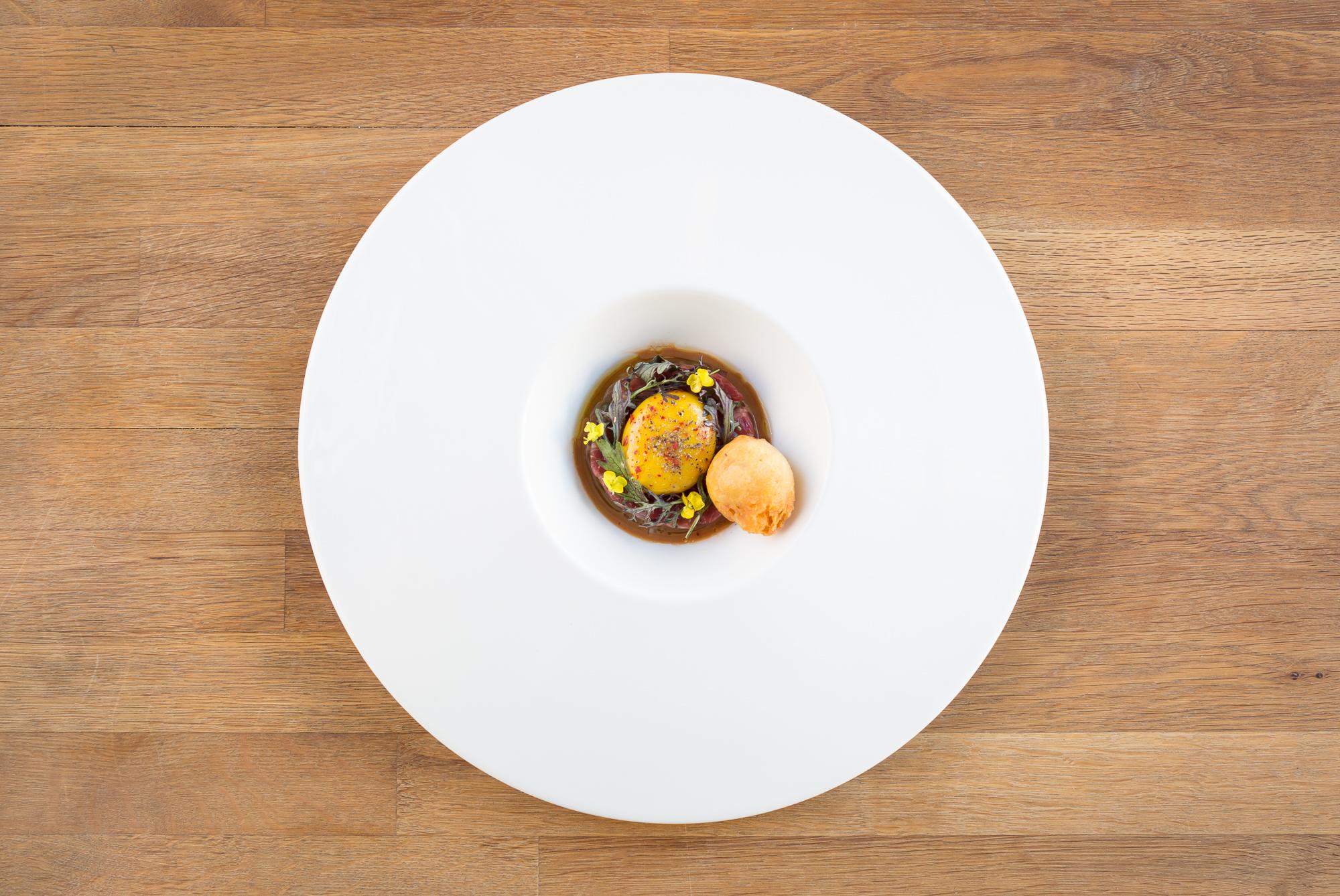 "lamb   dungeness crab beignet/hot mustard ""yolk""/cultured goat milk/red frill"