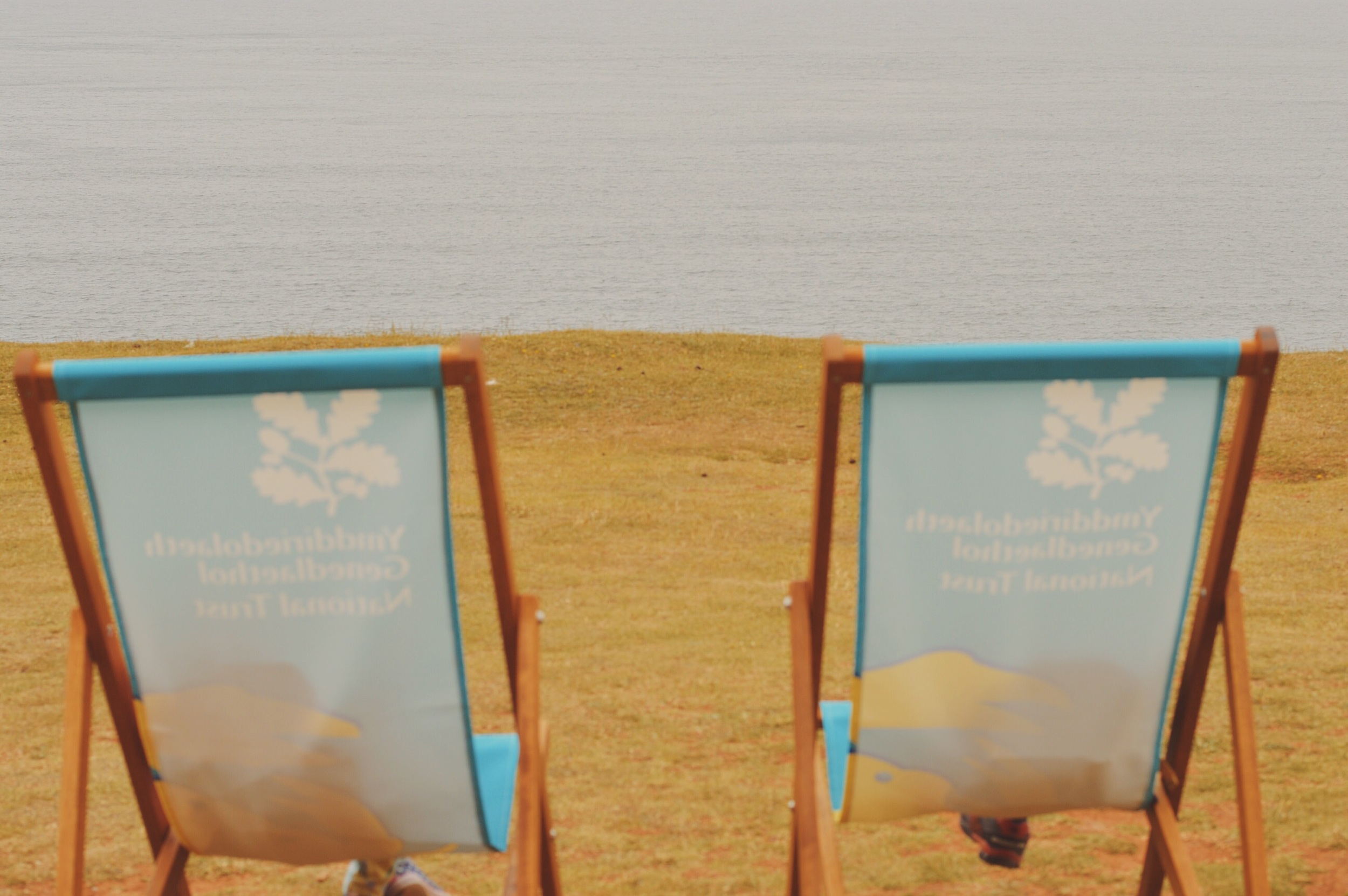 Lounging on the deckchairs at worms head.