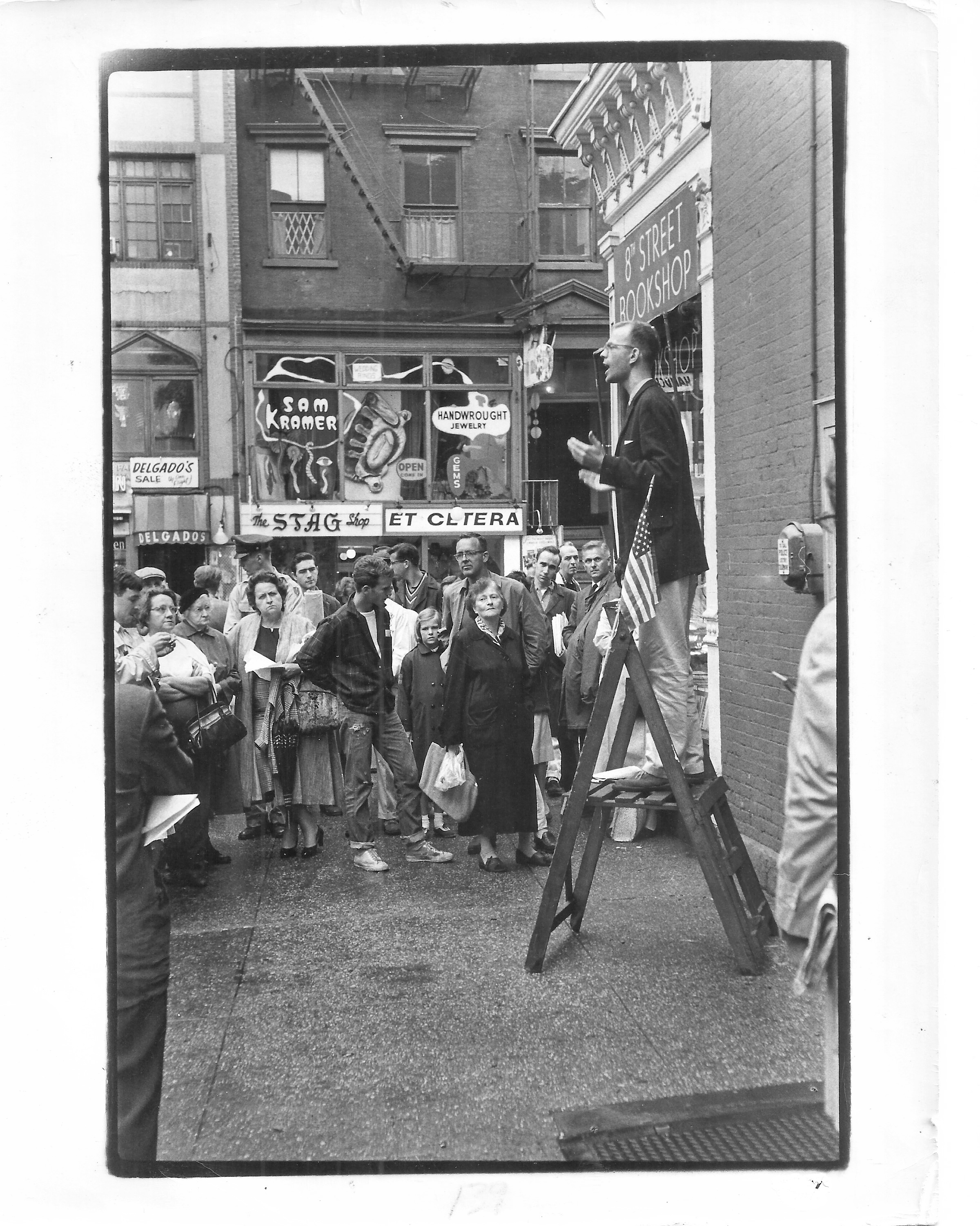 "Before: The corner of 8th St. and MacDougal in front of the famous 8th St. Bookshop. (Pictured is peace activist David McReynolds delivering a ""Ban The Bomb"" speech on September 18, 1960."