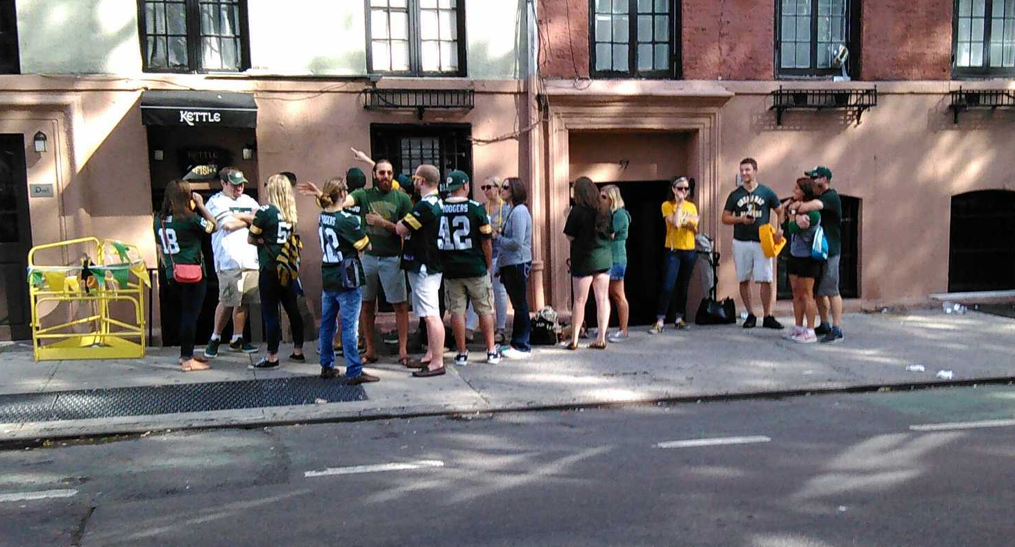 Green Bay Packers fans awaiting a Sunday opening of the Kettle of Fish bar, which hosts gathering of Wisconsin sports fans.