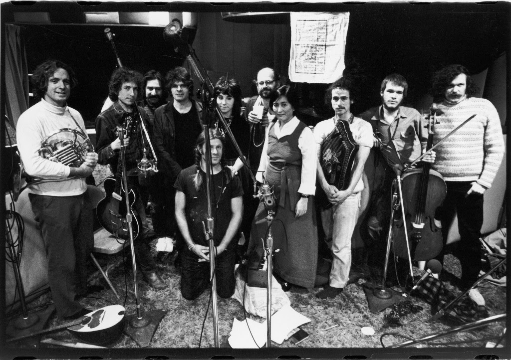 Bob Dylan and Allen Ginsberg, among others, pose for a group portrait by Fred W. McDarrah at a recording session, Record Plant studio, New York, November 13, 1971. Pictured are, from left, David Amram, Dylan, Happy Traum, Gregory Corso, Peter Orlovsky (kneeling, fore), Denise Mercedes, Allen Ginsberg, Sadi Kazi, John Sholle, Arthur Russell, and Ed Sanders.