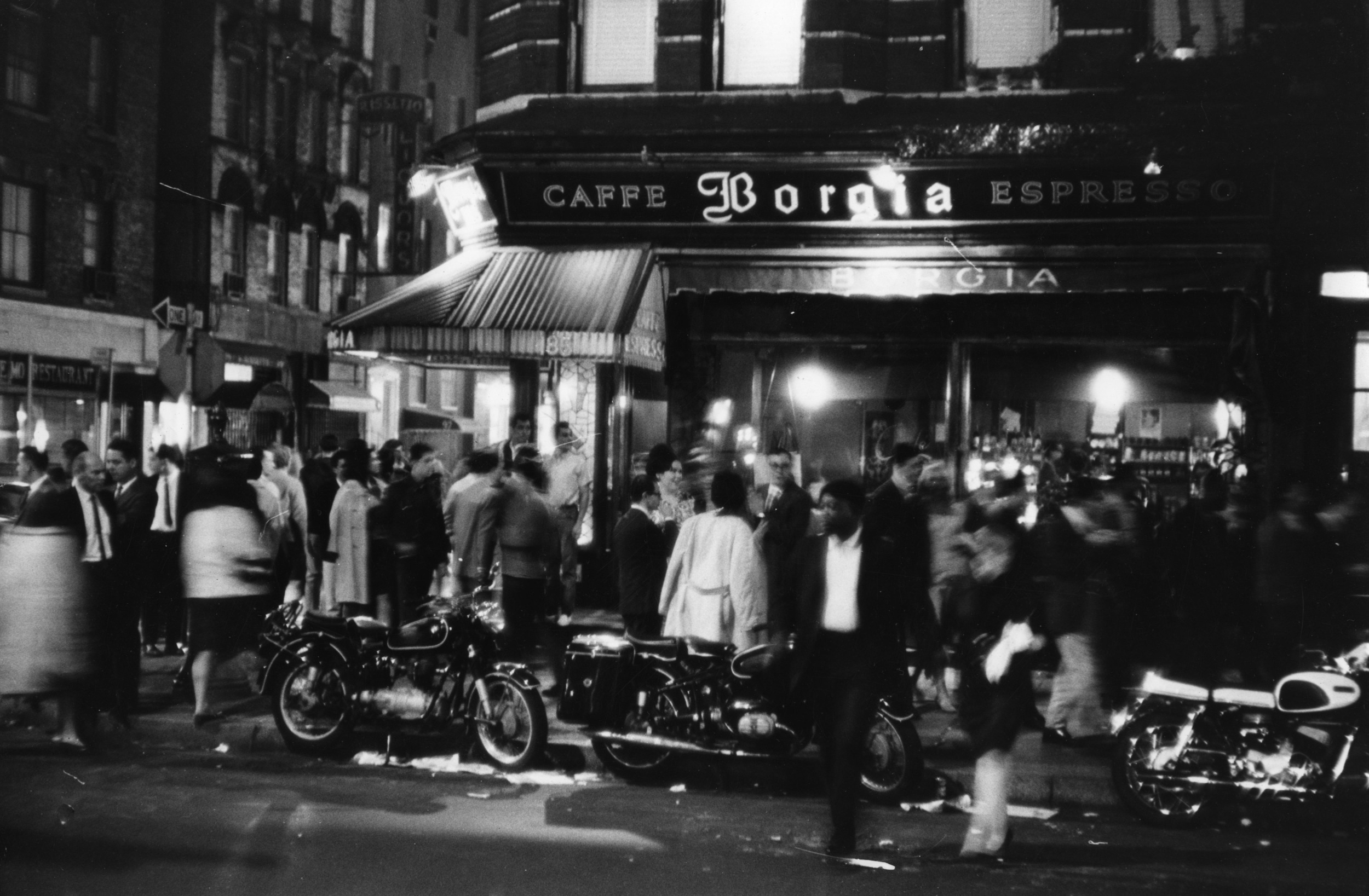Nighttime view of Cafe Borgia, MacDougal and Bleecker Streets, May 22, 1966. Below, same view in December, 2015. Photo by Fred W. McDarrah.