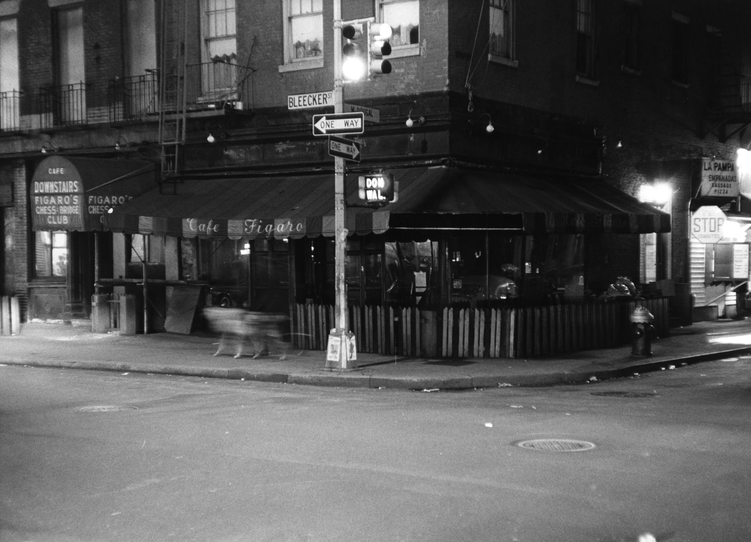 The Figaro Café, southeast corner of Bleecker and MacDougal, in 1969. Same spot, below, in April 2016. Photos © Estate of Fred W. McDarrah