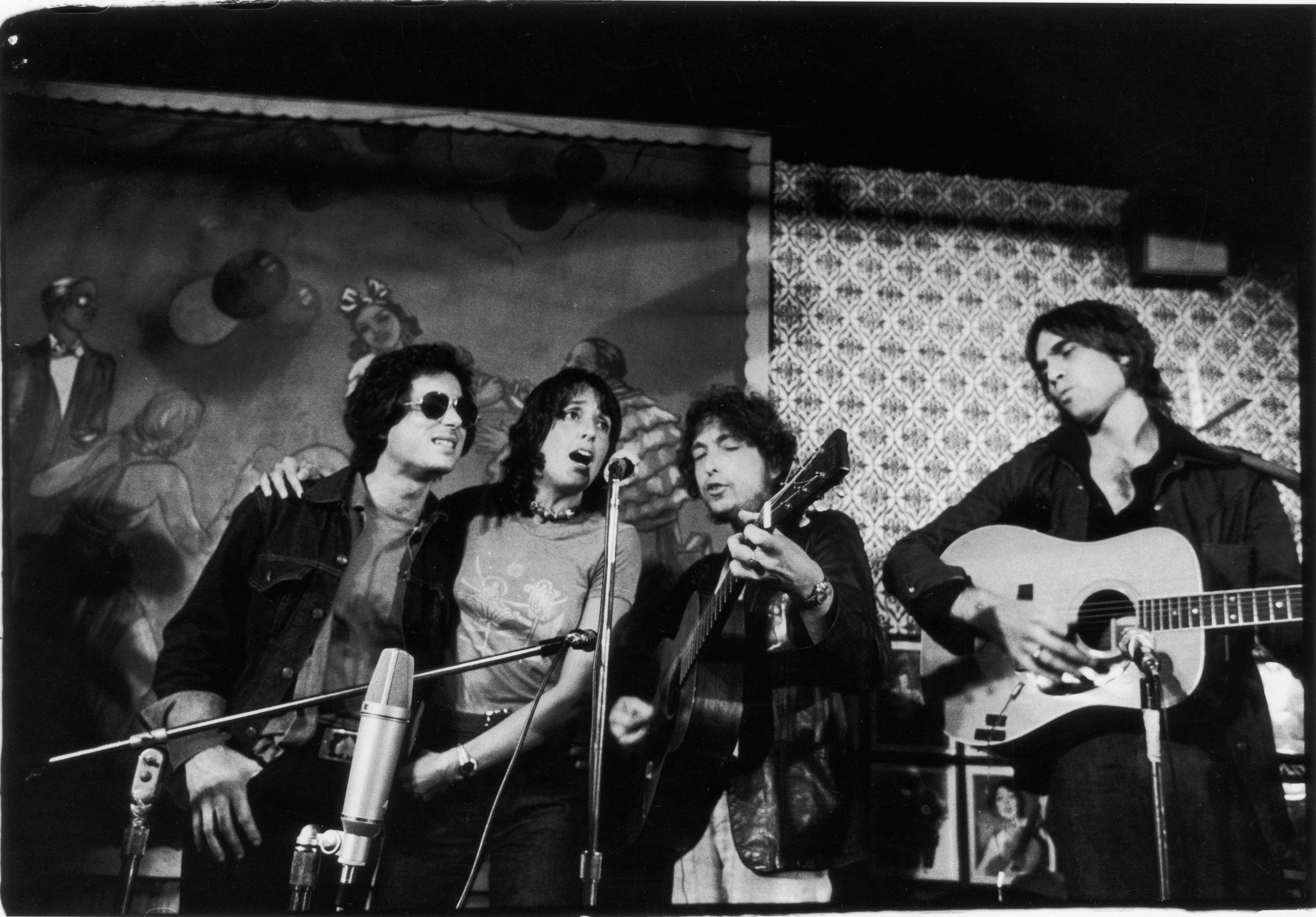 Rob Stoner, Joan Baez, Bob Dylan and Eric Anderson on stage at Gerde's Folk City, 130 West 3rd Street, October 23, 1975. Playing in honor of club owner Mike Porco's 61st birthday, the performance was also a dry run for Dylan's Rolling Thunder Revue tour, which began a week later. Photo © Estate of Fred W. McDarrah.