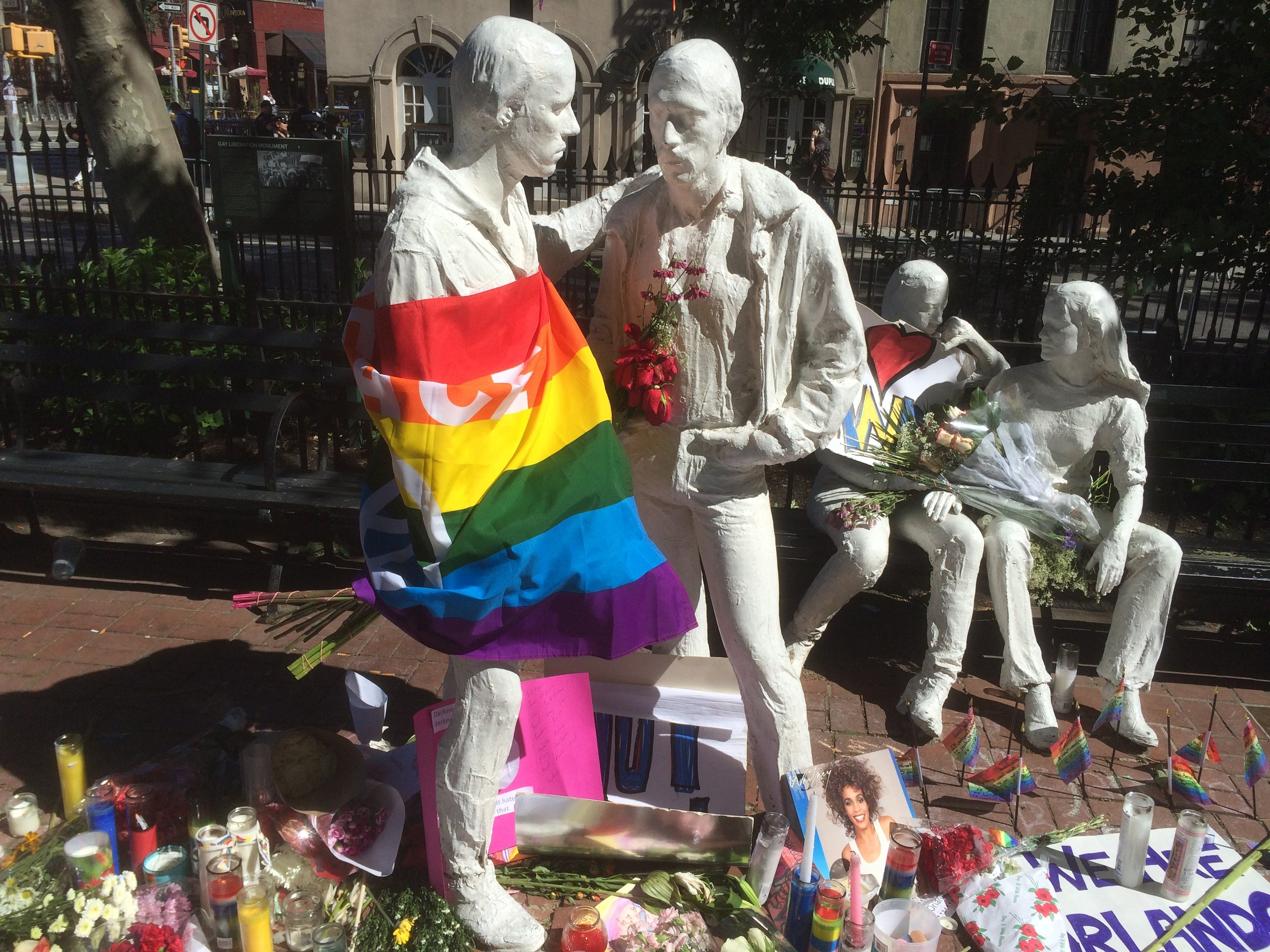 George Segal sculpture in Christopher Park, Four Figures, draped in colors after the June 2016 Orlando nightclub attack.