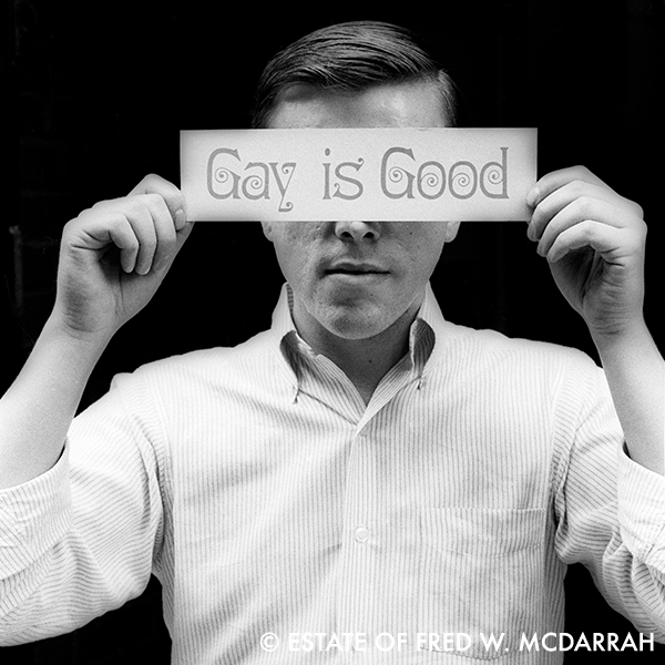 Portrait of American gay rights activist Craig Rodwell as he holds a bumper-sticker sized sign that reads 'Gay is Good' over his eyes, New York, New York, October 14, 1969. Rodwell was the founder of the Oscar Wilde Memorial Bookstore, the first bookstore in the country devoted exclusively to works by gay and lesbian authors.