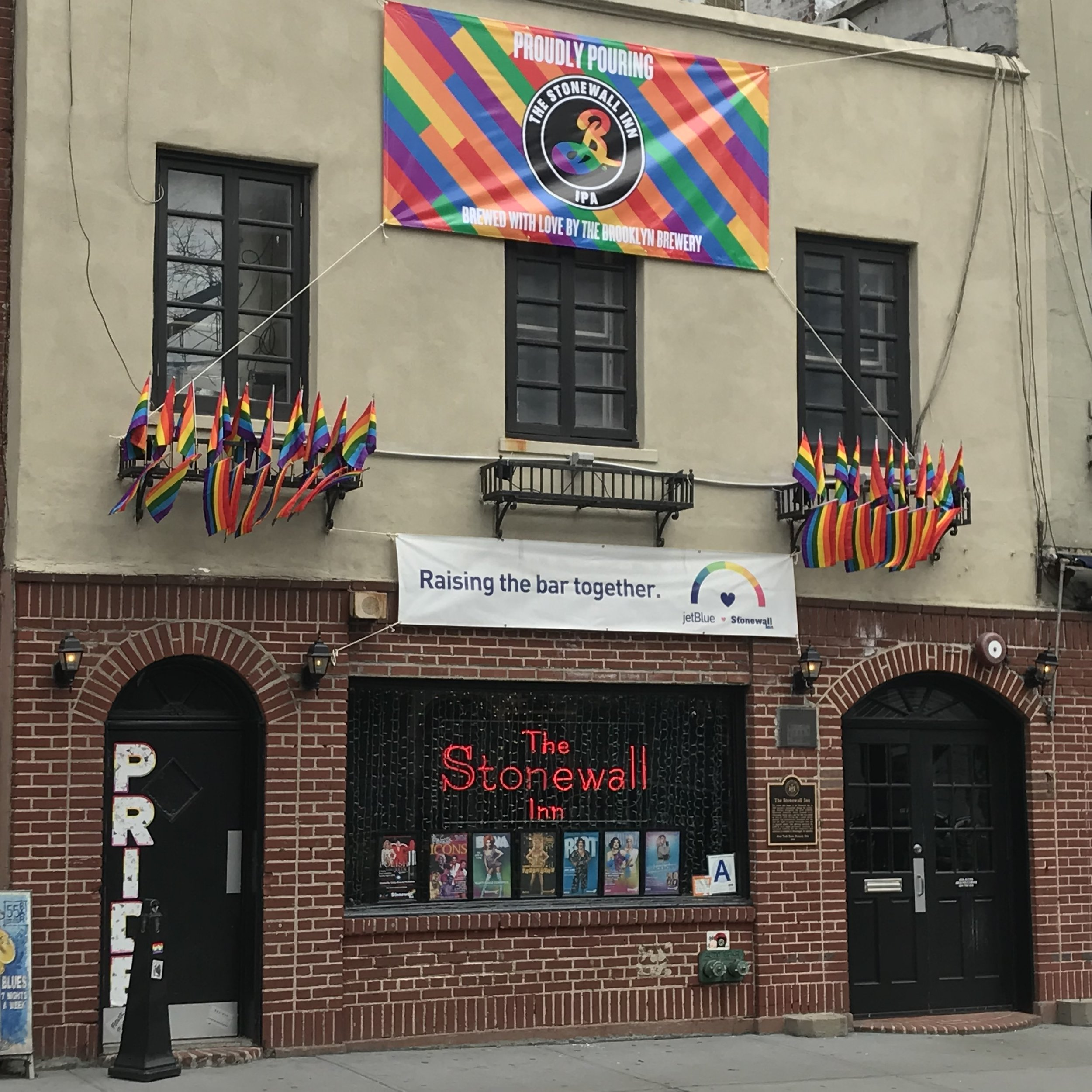 Stonewall Inn, with new Brooklyn Brewery banner.