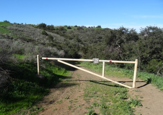 The gate that signals you are about to head downhill into the canyon.