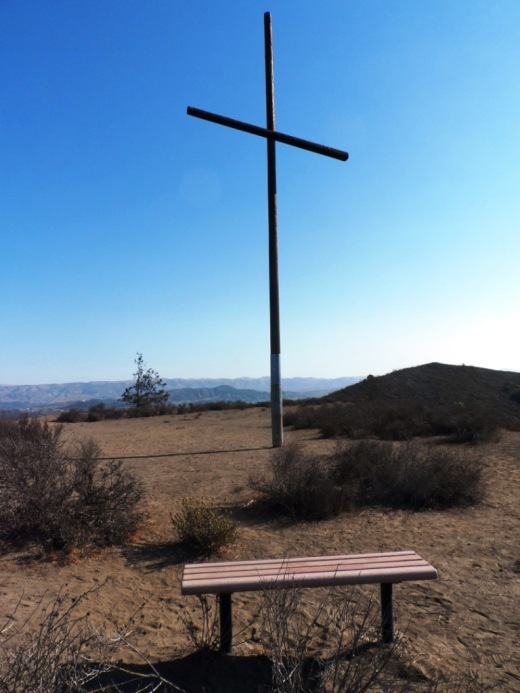 Two benches and a cross abpve CLU, east of the CLU sign, with panoramic views of the Conejo and Santa Rosa Valleys