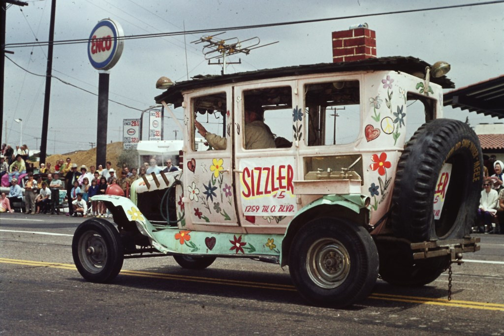 Conejo Valley Days Parade 1970 with auto promoting Sizzler.