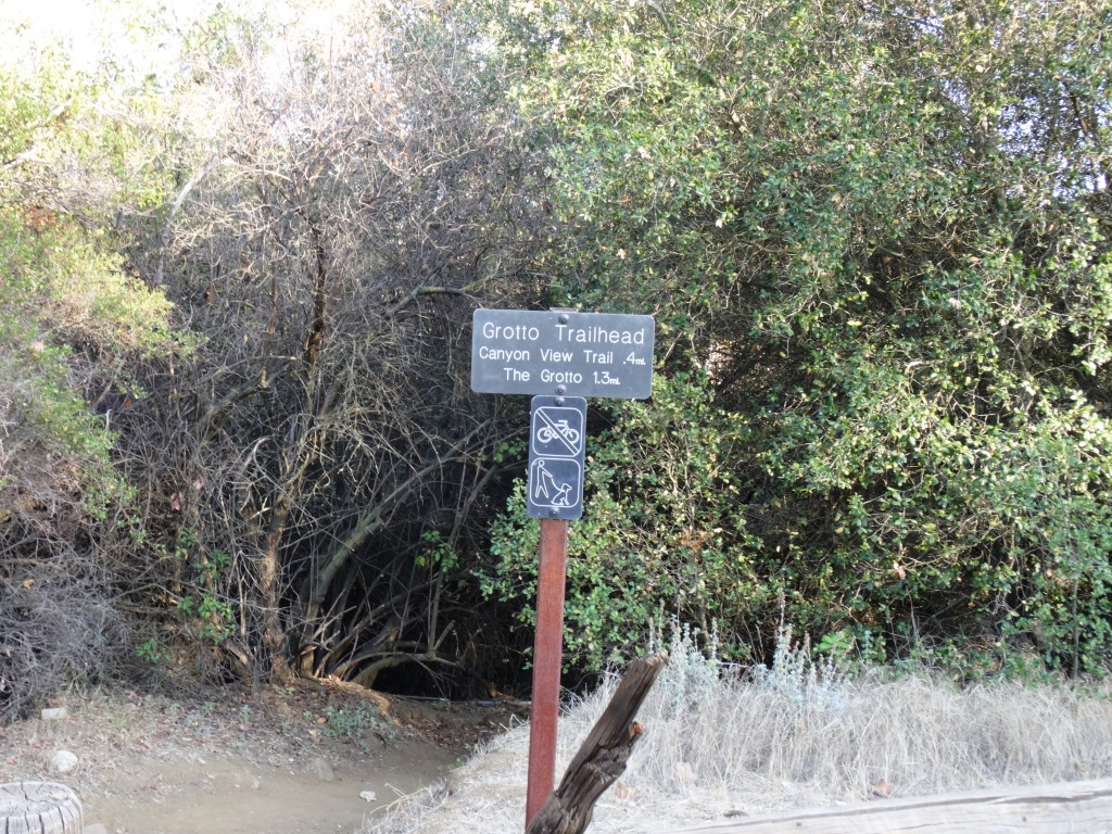 Grotto Trailhead sign adjacent to circle X campground