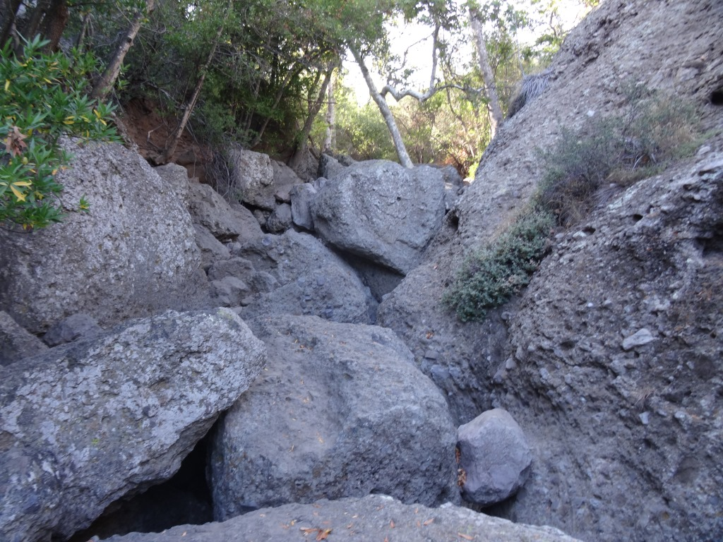 For many, this may be the endpoint for your hike once you see these boulders. But there's a path (I won't call it a trail, because it isn't) on the right hand side that, with a bit of patience, will get you to the cave below.