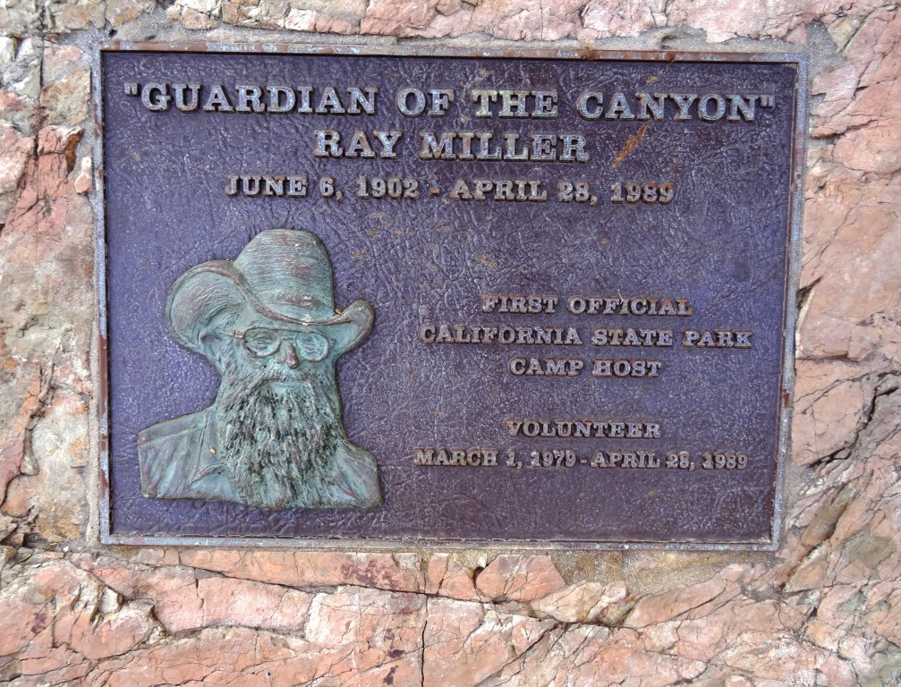 Monument to Ray Miller on boulder in the La Jolla Canyon Day Use parking lot.