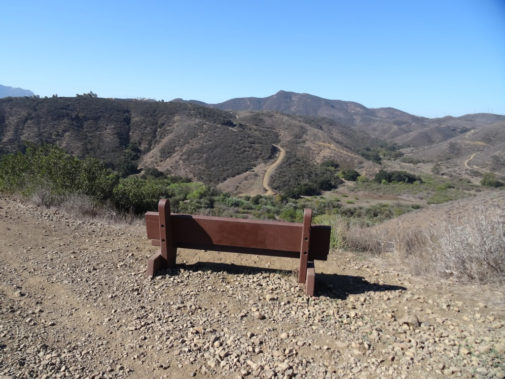 The first of two overlook benches facing west on the Lizard Rock Trail