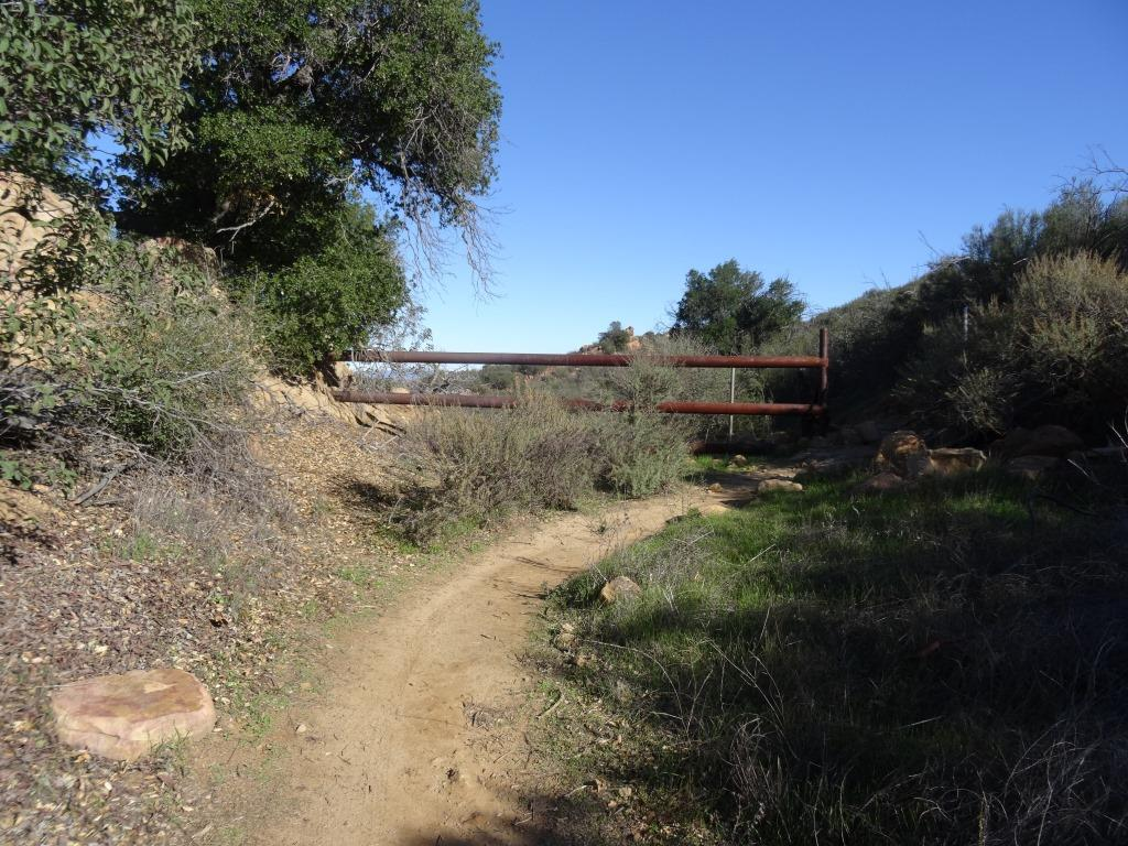 Here's a gate near to the top of the trail that tells you you are close to your destination.