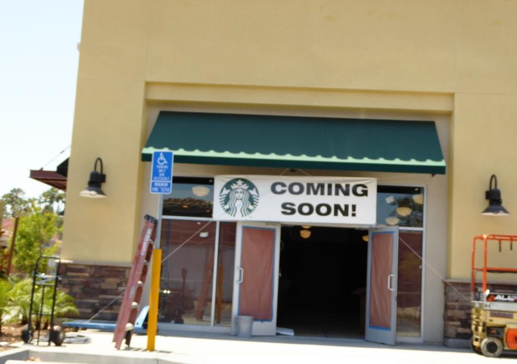The new Starbucks drive thru will be opening on July 14th. Start your engines.