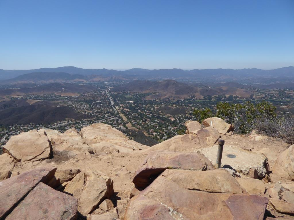 You are now at Simi Peak, the highest point of the Simi Hills. The round marker on the right is from the Ventura County Surveyor. In background is Lindero Canyon Road headed south.