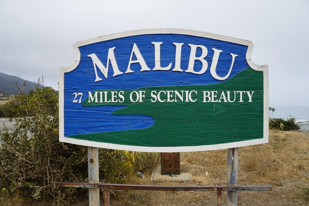 "This ""27 Miles of Scenic Beauty"" sign was swapped out for ""21 Miles of Scenic Beauty"" sign in April 2017 in order to correct the actual length of City of Malibu coastline."