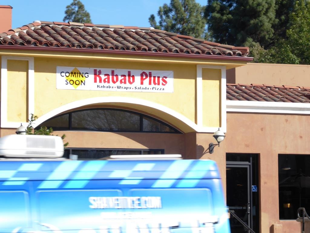 Kabab Plus sign is up; photobombed by a Shave It van!