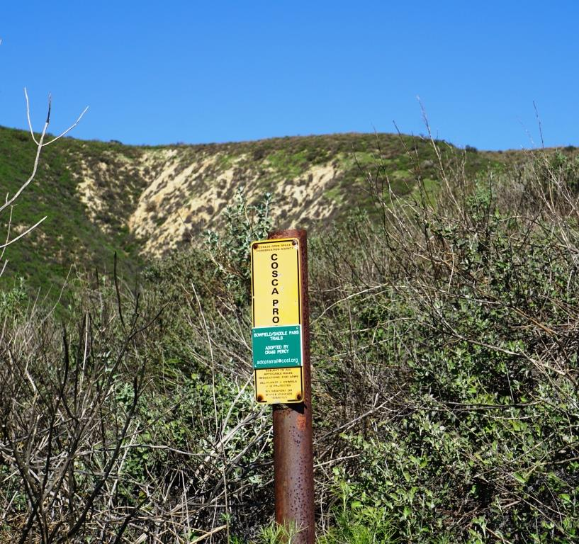 Small COSCA sign at the bottom of the steep hill from Canyon Oaks Park leading into the North Ranch Open Space.