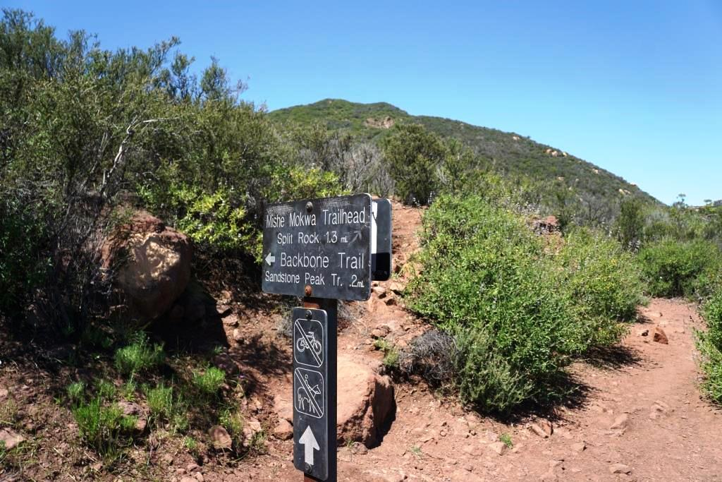 About .4 mile into the hike, you'll come to this sign. Continue towards Split Rock. Or you can take this short trail to the Backbone Trail and the more direct path to Sandstone Peak.