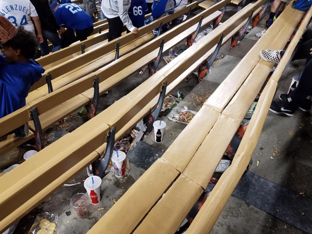 Quite a mess under the seats of the bleacher benches.