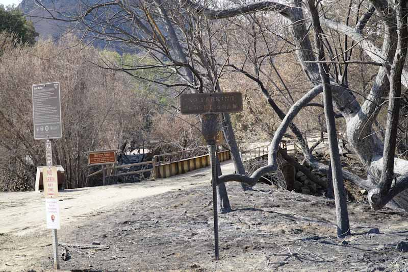 The Western Town sign and bridge is still there but most everything surrounding it is burnt after the Woolsey Fire of November 2018.