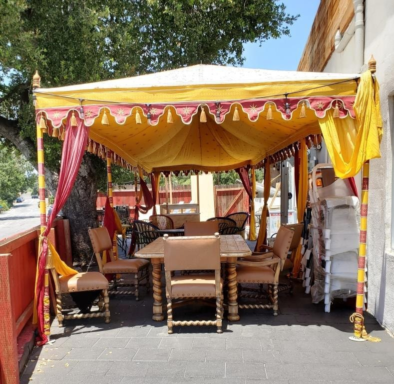 How cool is this outdoor covered eating area at Namaste Spiceland!