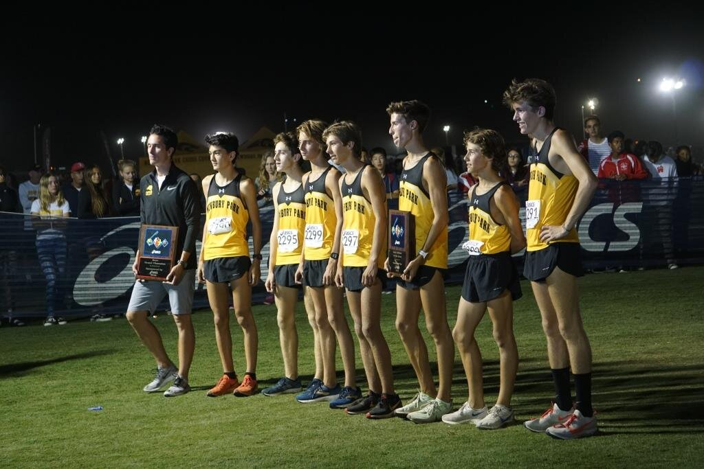 Record-setting Newbury Park High School Boys Cross Country Team receiving post-race accolades.